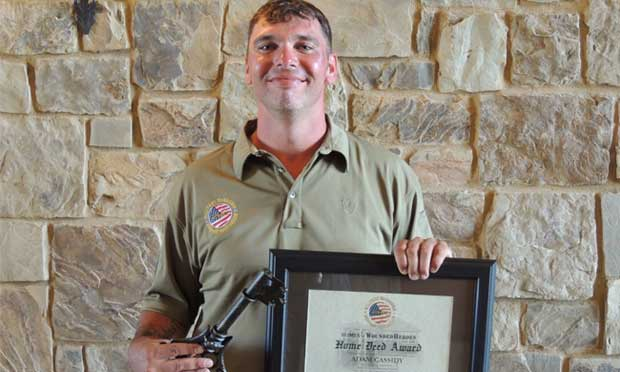 Adam Cassidy receives a house from the PGA Reach and Military Warriors at Colorado Golf Club