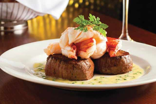 Seared Tenderloin with Butter Poached Lobster Tails from Capital Grille