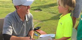 Duval signs autographs