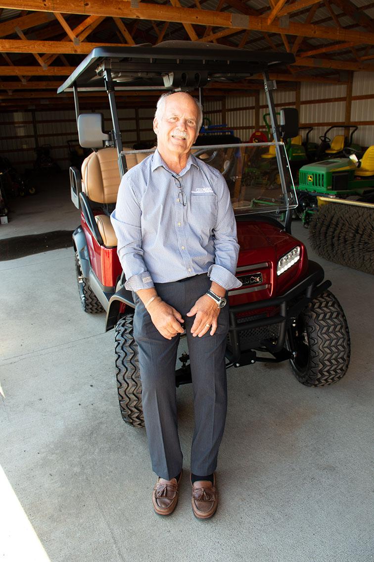 "Tom Bauerle with a ""lifted"" Onward Club Car."