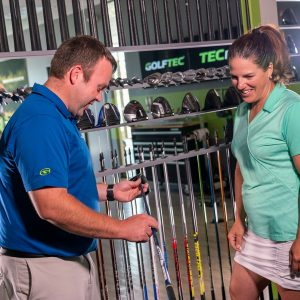 GOLFTEC employees helps player decide what driver shaft to use