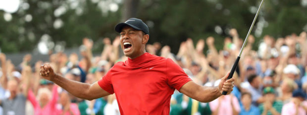 TIGER wins his fifth green jacket