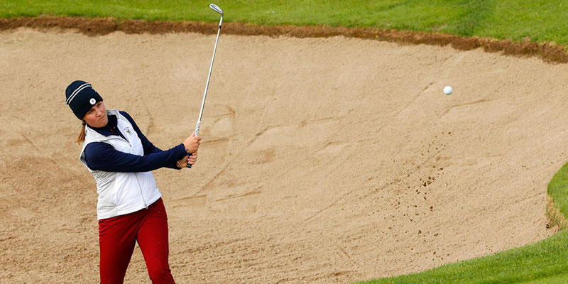 Jennifer Kupcho hits a shot from the bunker at the World Amateur Team Championship