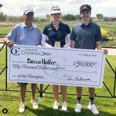 Huffer with her caddie and brother Zach and the 50,000 winner's check.
