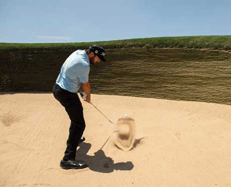 Denver Native Mark Hubbard hitting out of a deep bunker