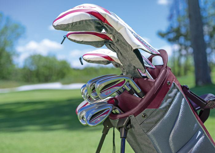 A set of Ping G Le2 golf clubs made for women.