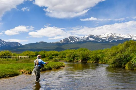 Charles Duke casts a line into the river in Colorado.