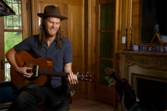 Wesley Schultz of The Lumineers jamming on the guitar